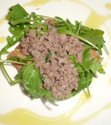 Bruschetta rucola e salsiccia aromatizzata bimby
