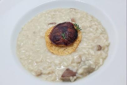 Porcini e risotto con cialda di grana padano