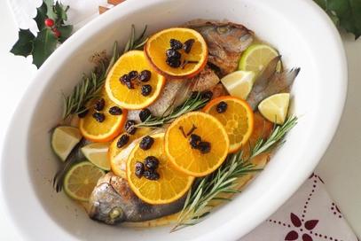 Orata al forno con arancia, lime e mirtillo rosso